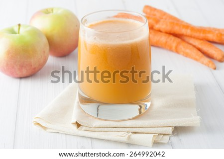 close up of fresh homemade apple carrot juice in a glass  - stock photo