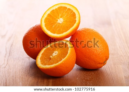 Close up of fresh oranges on wooden board