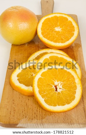 Close up of fresh oranges on wooden board. Studio shot
