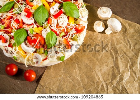 Close-up of fresh pizza lying on the baking paper