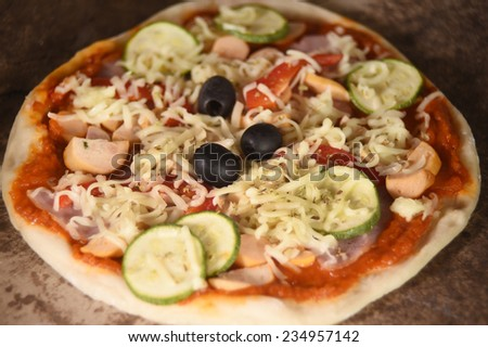 Close up of fresh pizza on wooden board.
