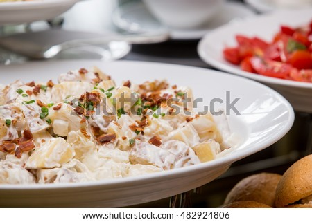 Close up of fresh potato salad with crispy bacon,selective focus