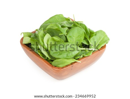 close up of fresh spinach leaves in a bowl