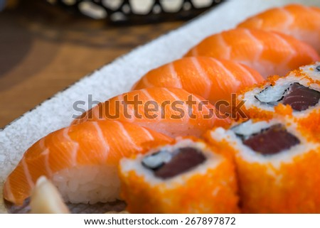 Close up of fresh tuna california maki and salmon sashimi for Japanese food background - stock photo