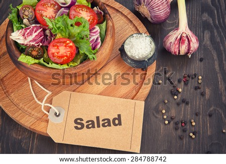 close up of fresh vegetable salad in bowl - stock photo