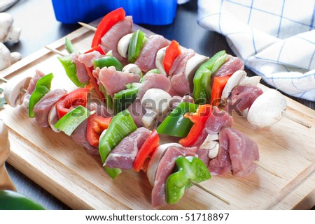 Close up of freshly made ready for cooking meat sticks - stock photo