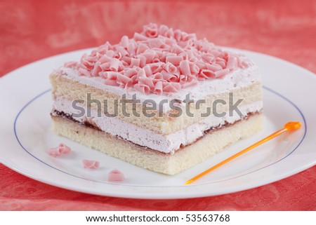 Close up of freshly made sweet dessert on pink background - stock photo