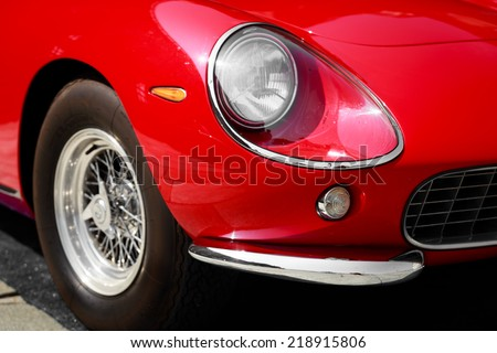 close-up of front right front of a red vintage car - stock photo