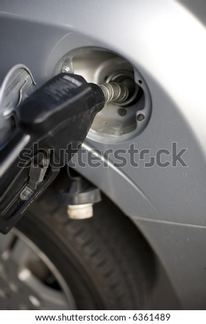 close-up of fuel pump in gas tank - stock photo