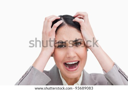 Close up of furious businesswoman against a white background - stock photo