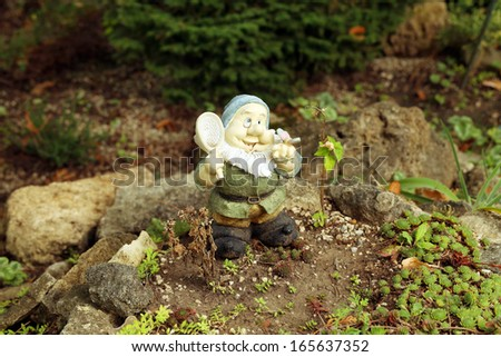 Close up of garden gnome. Whole background. - stock photo