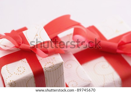 Close up of gift box with red bow isolated on white background - stock photo