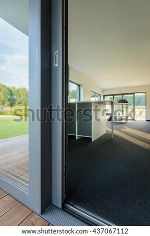 Close up of glass balcony doors, external view of a spacious villa interior - stock photo