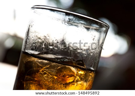 Close-up of glass with whiskey - stock photo