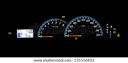 Close up of glow dashboard car speed meter - stock photo