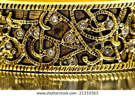 close-up of gold bracelet with diamonds - stock photo