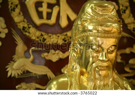 close-up of golden chinese sculpture in temple - stock photo
