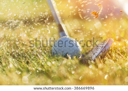 Close-up of golf ball during sunrise. - stock photo