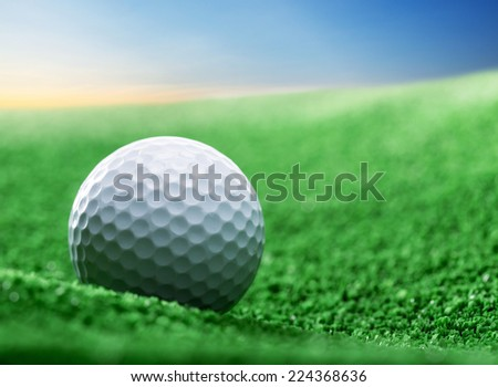 Close up of golf ball on green tee - stock photo