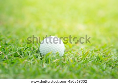 Close up of golf ball on tee, - stock photo