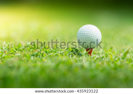 Close up of golf ball on tee,Paste the text into the space left. - stock photo