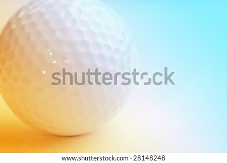 Close-up of golf ball overlaid with yellow and blue color - stock photo