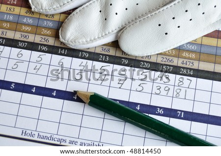 Close up of Golf Score Card with Glove and Green Pencil - stock photo