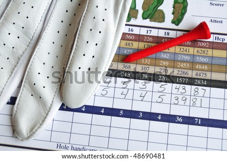 Close up of Golf Score Card with Glove and Red Tee - stock photo