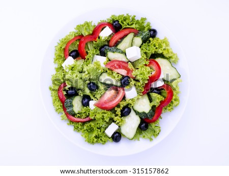 Close-up of greek salad on isolated background - stock photo