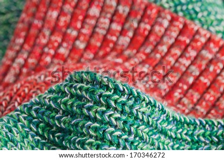 Close up of green and red wool fabric with a shallow depth of field