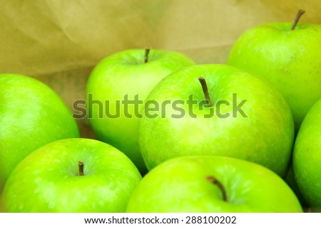 Close up of green apples in shopping bag - stock photo