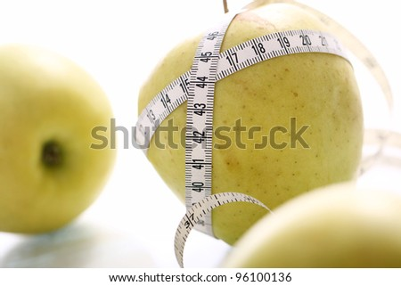 Close up of Green apples with measure tape