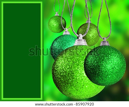 Close up of green christmas bauble balls in different sizes  hanging on strings