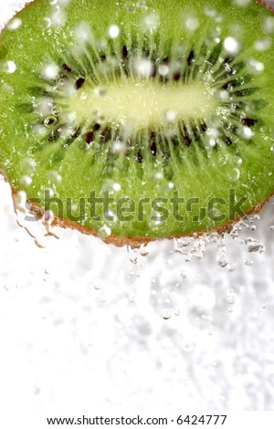 close up of green fresh fruit under the water - stock photo