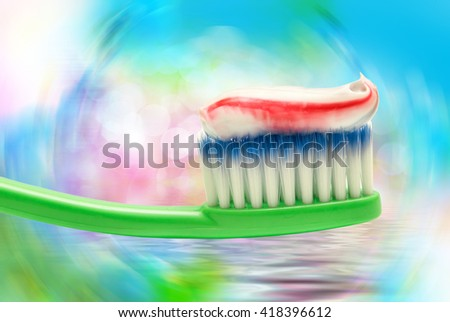 Close up of green plastic toothbrush on bright background - stock photo
