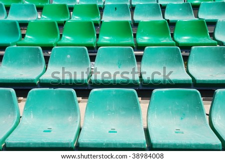 close up of green seats on a beach stadium - stock photo