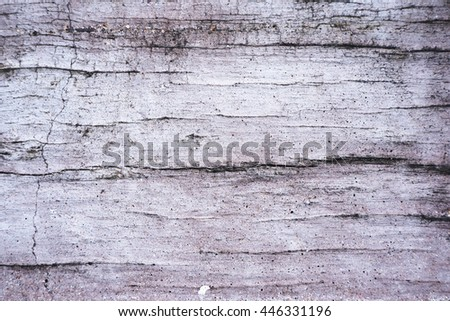 Close up of grey concrete wall background texture with wooden pattern - stock photo