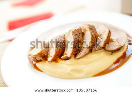 Close-up of grilled pork with mashed potatoes as main course at local restaurant - stock photo
