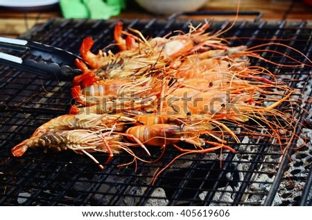 close up of grilled shrimps on gridiron, shrimp barbecue - stock photo