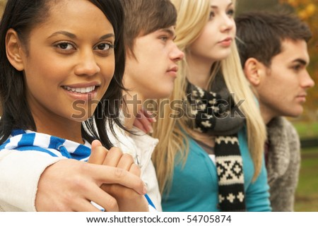 Close Up Of Group Of Four Teenage Friends In Autumn Woodland - stock photo