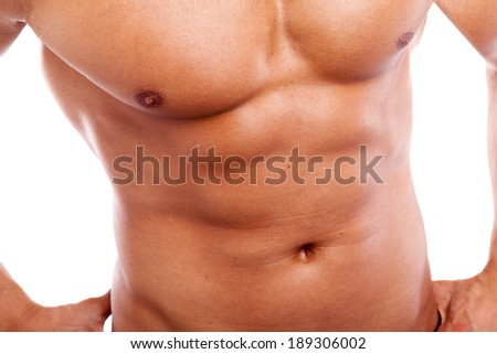Close-up of guy with muscular torso  - stock photo