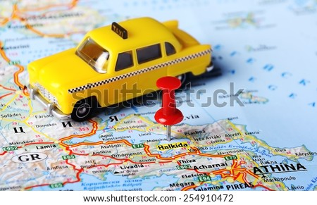 Close up of Halkida , Greece map and taxi toy - Travel concept  - stock photo