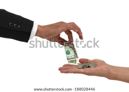 Close up of hand giving a dollar to a cupped hand with change in it - stock photo
