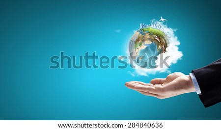 Close up of hand holding Earth planet. Elements of this image are furnished by NASA - stock photo