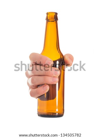 Close-up Of Hand Holding Empty Beer Bottle On White Background - stock photo