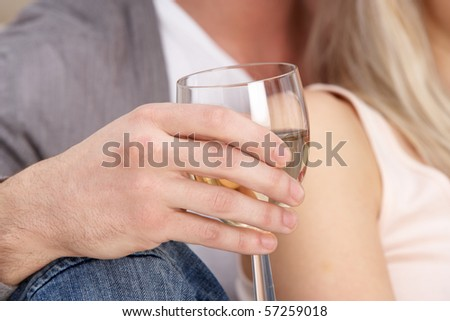 Close Up Of Hand Holding Glass Of White Wine - stock photo