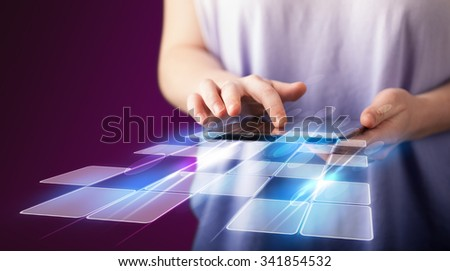 Close up of hand holding tablet with cyber application concept on background