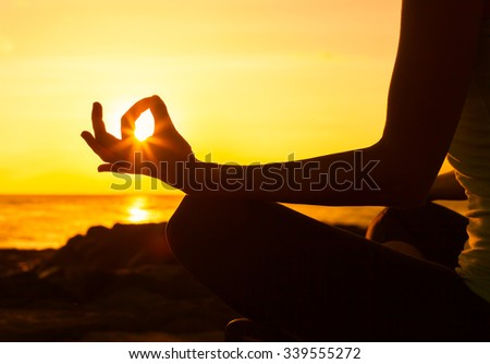 Close up of hand in a meditation pose - stock photo