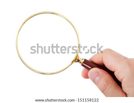 Close-up of hand looking through magnifying glass over white background - stock photo