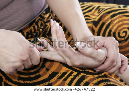 close-up of hand massage in the art of Thai massage studio